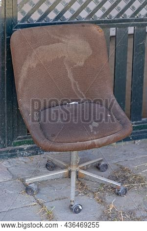 Old Brown Beaten Up Office Chair Outside