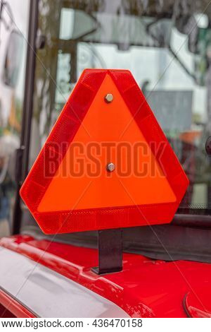 Big Red Reflective Safety Triangle At Farm Tractor