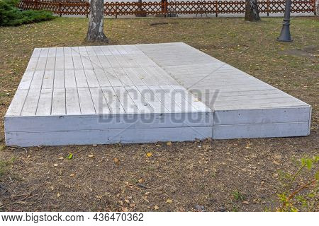 Empty Wooden Plank Boards Podium Stage In City Park