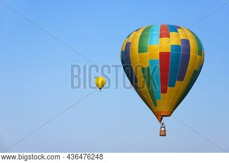 Colorful Hot Air Balloon Flying On Sky. High Quality Photo