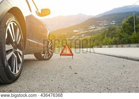 An Emergency Stop Sign Of A Vehicle Is Installed On The Road, Next To The Car. Copy Space.