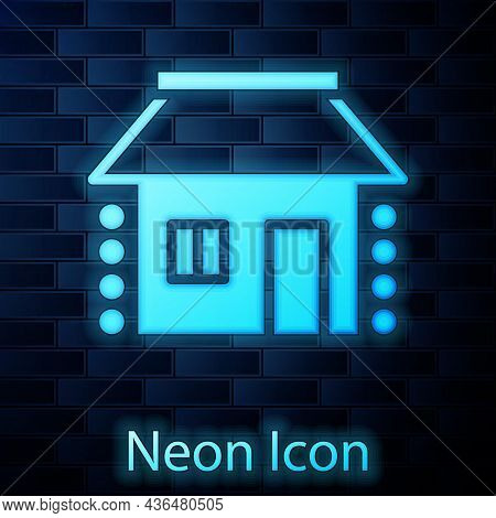 Glowing Neon Old Ukrainian House Hut Icon Isolated On Brick Wall Background. Traditional Village Hou