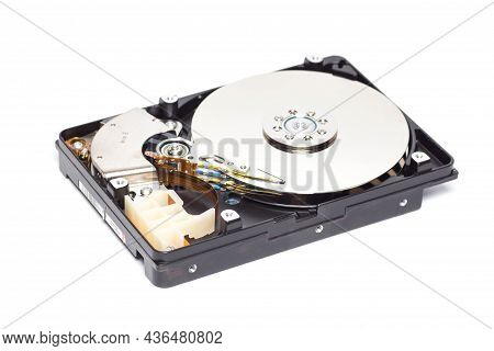 Opened Hard Disk On A White Background With Tools