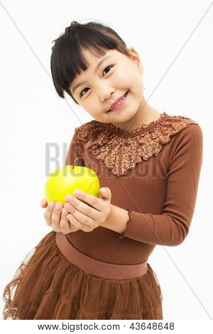 Cute asian kid with an apple