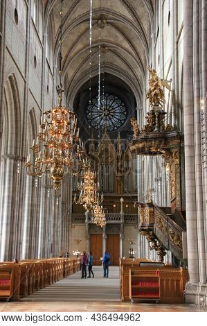 Sweden, Uppsala - April 19 2019: Interior View Of Uppsala Cathedral, Vaulted Ceiling And Chandeliers