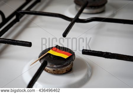 Natural Gas Exports And Imports. High Price. German Flag On Gas Stove