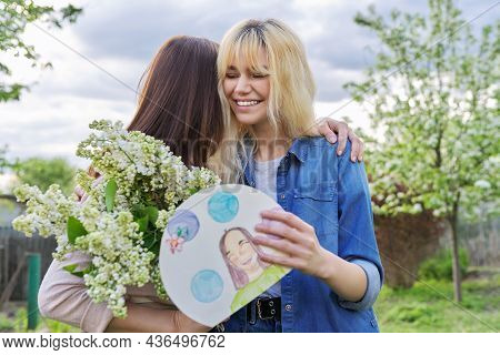 Mothers Day, A Female Teenager Congratulating Her Mother