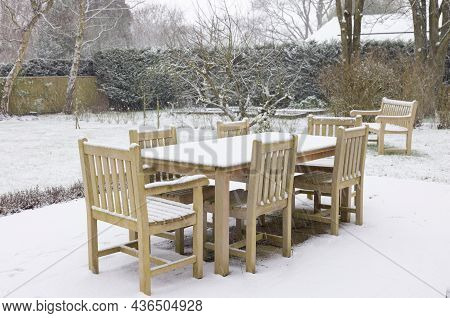 Patio Garden Furniture, Wooden Table And Chairs Covered With Snow In Winter, Uk
