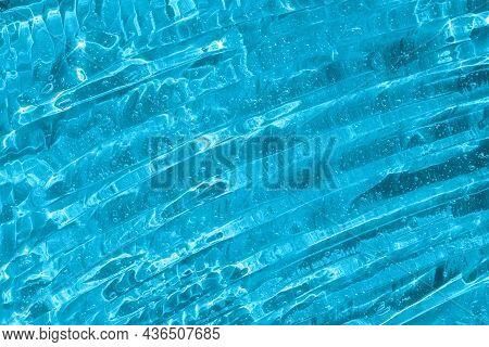 Clear Transparent Skincare Product Sample Closeup. Blue Gel Texture. Hand Sanitizer, Alcohol Gel, Mo