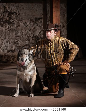 Serious mature medieval mercenary kneeling next to dog poster