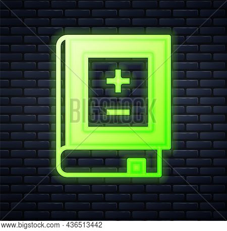 Glowing Neon Book With Mathematics Icon Isolated On Brick Wall Background. Math Book. Education Conc