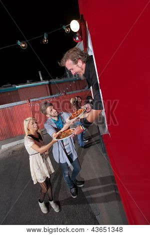 Teenagers Ordering Pizza From Food Truck