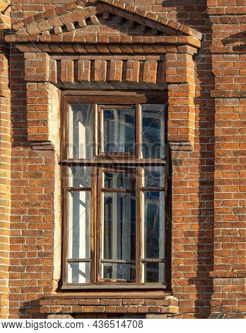 The Window Of The Old Mansion 19 Century With Brown Bricks Wall. Brick Wall Of An Old 19th Century B