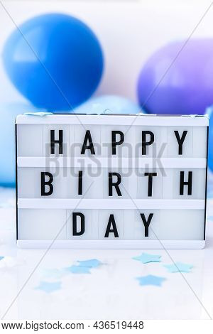 Lightbox With Text Happy Birthday On Abstract Defocused Blurred Festive Background For Holiday. Blue
