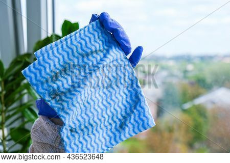 Employee Hand In Rubber Protective Glove Holding Dirty Micro Fiber Cloth Wiping Window From Dust. Ge