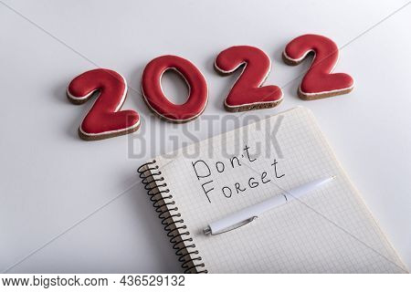 Numbers 2022 And Notebook With Inscription Dont Forget. Wish List And Goals For 2022