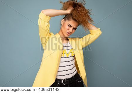 Young Crazy Funny Beautiful Curly Brunette Woman With Sincere Emotions Poising Isolated Over Backgro