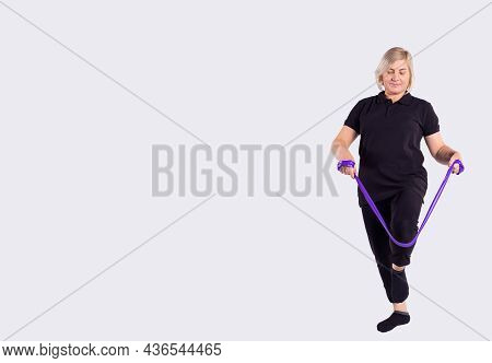Squat With Resistance Band Row. Quadriceps Training. Senior Woman Exercises At Home. Fitness, Squatt