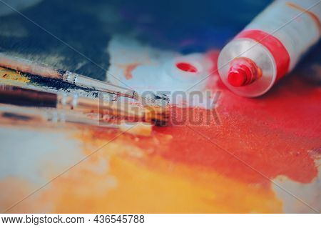 On The Palette, Painted With Different Bright Colors, There Is A Tube Of Pink Artistic Oil And Three