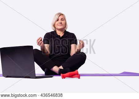 Happy Old Middle Aged Senior 50s Woman Learning To Meditate At Home Watching Live Online Tv Yoga Cla