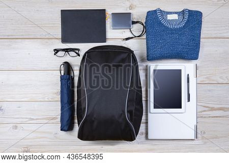Flat Lays Concepts. Top View Flat Lay Of Backpack With Laptop And Tablet, Mobile Phone With Mouse An