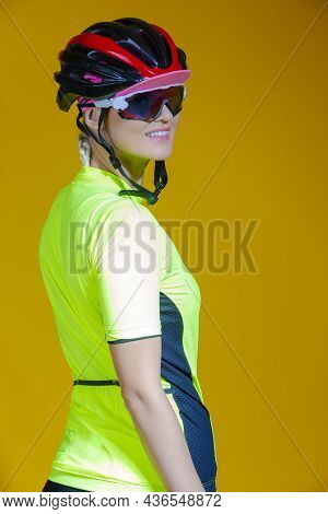Female Cycling Ideas. Portrait Of Positive Female Road Cyclist In Professional Sport Outfit Posing A