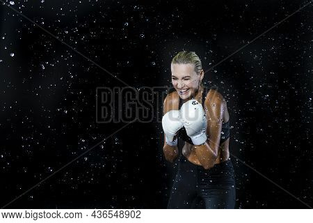 Laughing Female Boxer Posing In White Gloves And Making Hit Against Multiple Water Droplets.