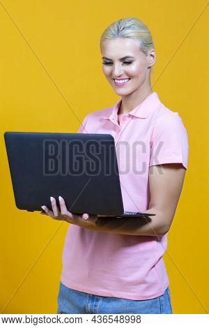 Lifestyle Concepts.smiling Caucasian Blond Girl With Laptop Posing With Smile Against Colorful Yello