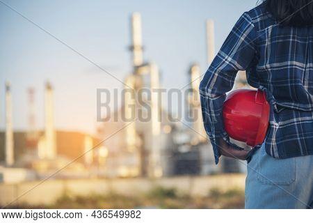 Woman Emergency Workers Hands Holding Hardhat Red Work Helmet Engineer. Refinery Plant Woman Worker