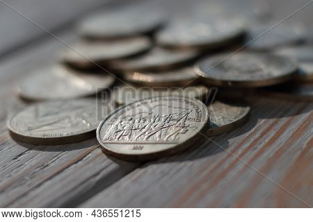 Soviet Jubilee Rubles On Wooden Background Closeup. Shallow Depth Of Field