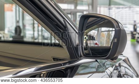 Close-up View Of Rearview Mirror And Modern Car Interior. A Rear View Mirror On A Car Door. New Car