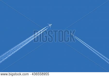 Two Large Passenger Supersonic Airliners Planes Approaching To Each Other Flying On Counter Courses