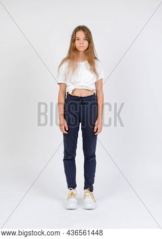 Young Girl Model Snap In Blue Trousers And White T-shirt Front Look Full Length On White Background