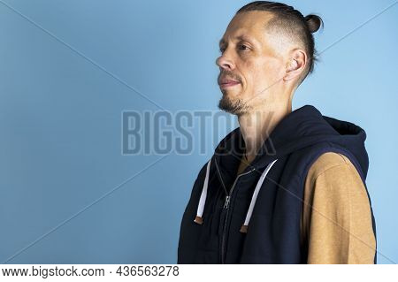 Close Up Side Profile Photo A Man With A Hairstyle Top Knot Or A Man's Bun On A Blue Background, Men