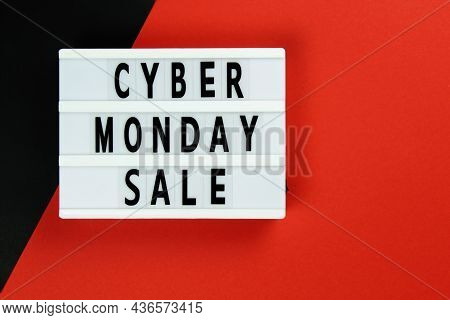Cyber Monday Sale Text On Lightbox On A Red Black Background. Creative Top View Flat Lay Promotion C