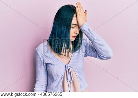 Young modern girl wearing casual jacket surprised with hand on head for mistake, remember error. forgot, bad memory concept.