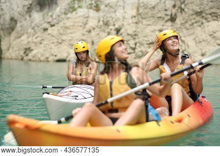 Excluded Angry Woman Being Ignored By Her Friends In A Kayak In A Lake