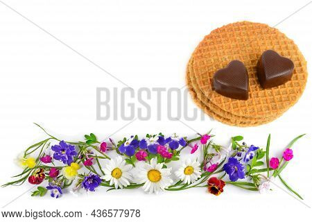 Chocolate In The Form Of Hearts On Belgian Waffles And A Composition From A Bouquet Of Flowers Isola