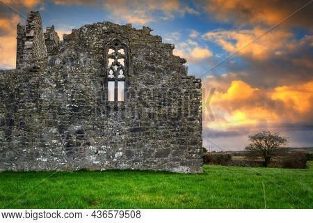 Ruins of Clare Abbey in Ennis at sunset, Ireland