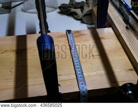 Tape Measurer On Glued, Clamped  Alder Wood Boards , Carpenter Measuring The Width Of The Board.