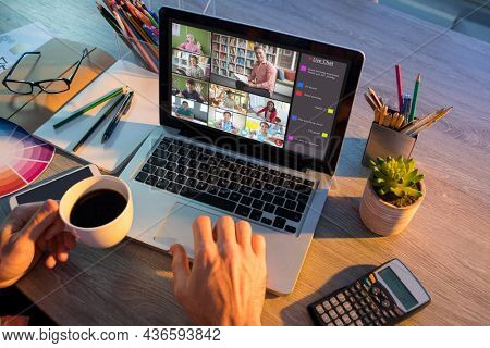 Hands of man using laptop for video call, with smiling diverse elementary school pupils on screen. communication technology and online education, digital composite image.