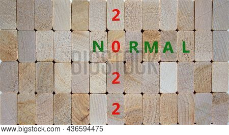 Symbol Of Covid-19 Normal In 2022. Wooden Blocks With Words 'normal 2022'. Beautiful Wooden Backgrou