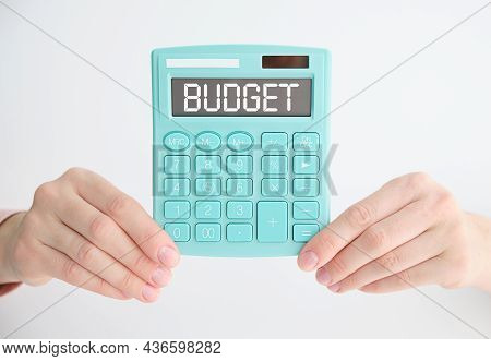 Word Budget And A Calculator With Numbers 2022. Accumulating Money And Planning A Budget. Business A