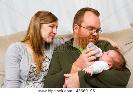 Parents Bottle Feeding Baby