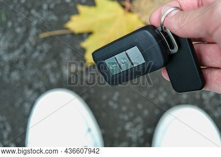 A Person Found And Picked Up From The Ground Lost Car Auto Keys.