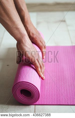 Close-up Image Of A Mans Hands Unrolling The Sports Mat Preparing To Do A Productive Workout. Man Ha