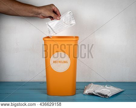 Throw The Face Mask Into A Waste Container. Waste Sorting And Recycling