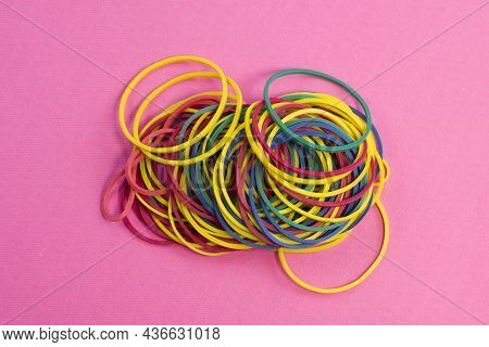 Wulti Colored Rubber Bands For Money On Bright Pink Textured Background