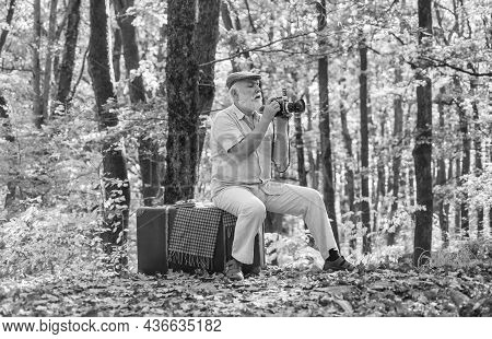 Pension Hobby. Retro Photographer. Used To Manual Settings. Old Man Shoot In Nature. Landscape And N