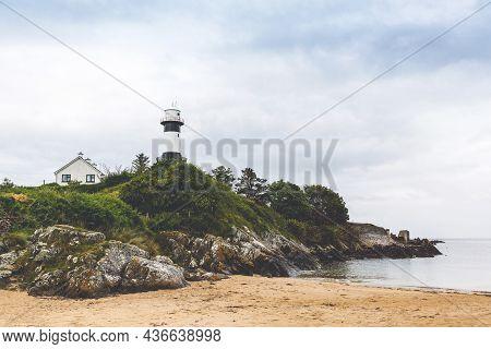 Lighthouse On Inishowen Peninsula In North Ireland. Beautiful Wild Atlantic Way With Typical Irish L